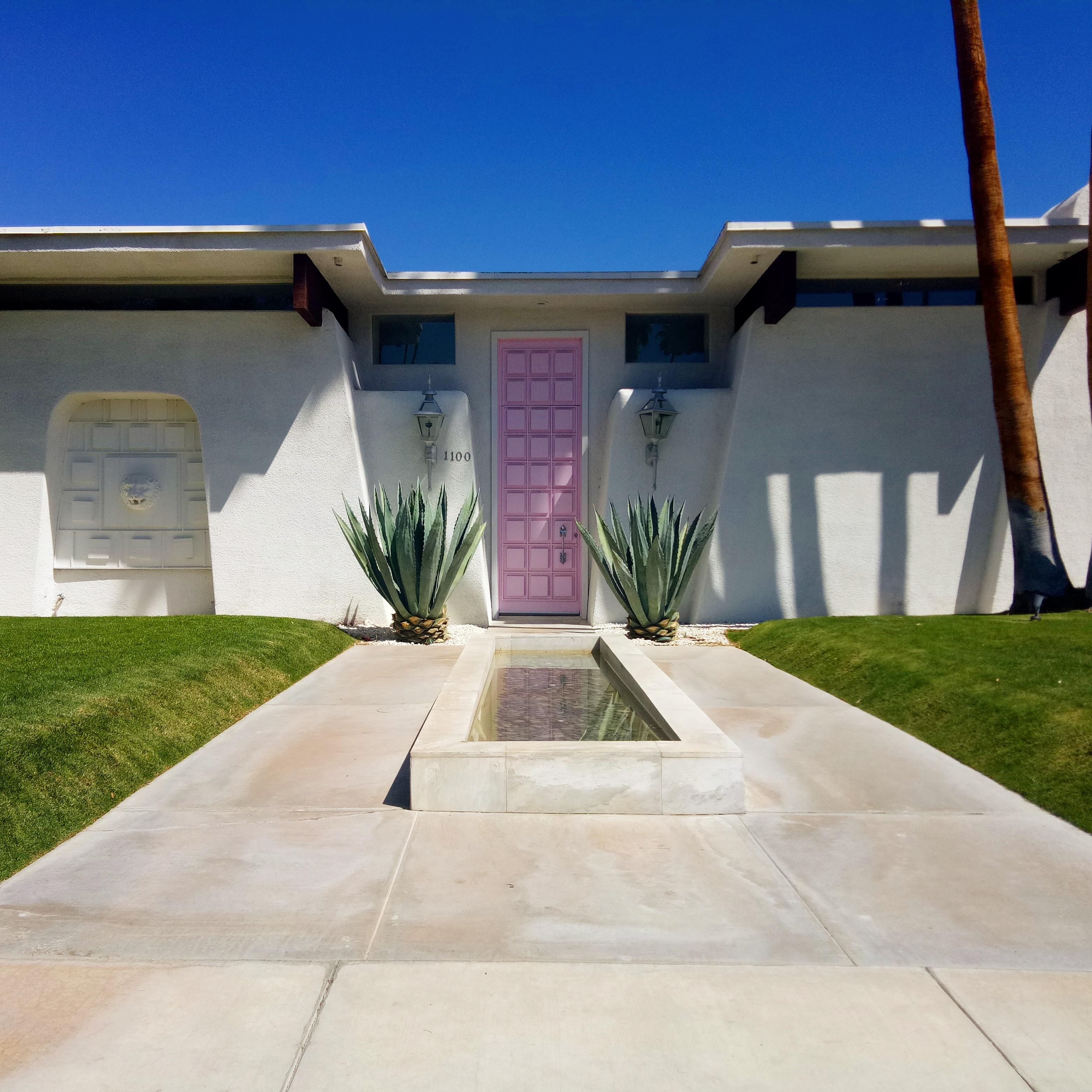 palm springs pink door mid century modern house